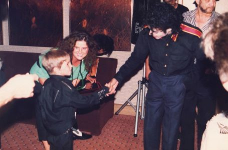 A young Wade Robson shaking hands with pop icon Michael Jackson in 1987, in a scene from HBO's documentary, 'Leaving Neverland.' | Photo Credits: Dan Reed/HBO via AP