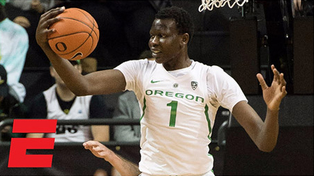 photo: Bol Bol wearing home Oregon Ducks Basketball jersey | (Credits: ESPN)