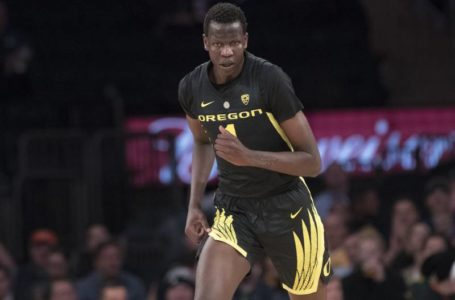 photo: Bol Bol wearing black and gold Oregon Ducks Basketball jersey | (Credits: Mary Altaffer/Associated Press)