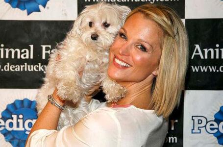 Juliet Huddy hold pet dog.