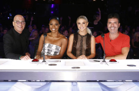 "Celebrity judges, from left, Howie Mandel, Gabrielle Union, Julianne Hough, Simon Cowell on the set of ""America's Got Talent,"" in Los Angeles. (Trae Patton/NBC via AP)"