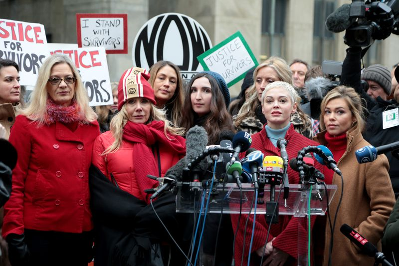 (L-R) Louise Godbold, Rosanna Arquette, Dominique Huett, Sarah Ann Masse, Paula Williams (partially obscured), Rose McGowan and Lauren Sivan at a press conference held by a group of women called Silence Breakers outside Manhattan Criminal Court after Weinstein's arrival on Jan. 6, 2020, in New York City. (Luiz C. Ribeiro/for New York Daily News)